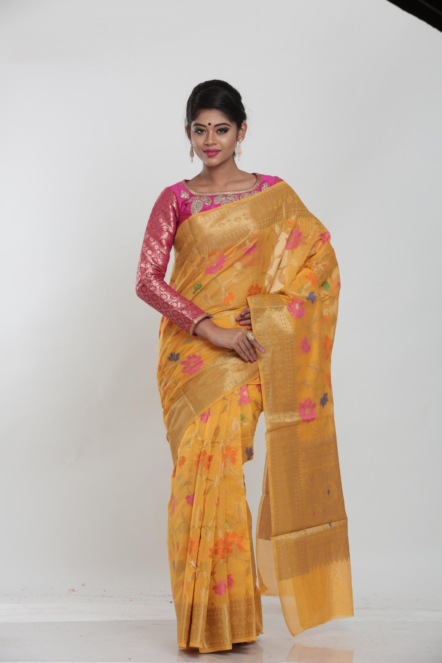 YELLOW COLOUR CHANDERI SILK SAREE WITH ALL OVER FLORAL WEAVING
