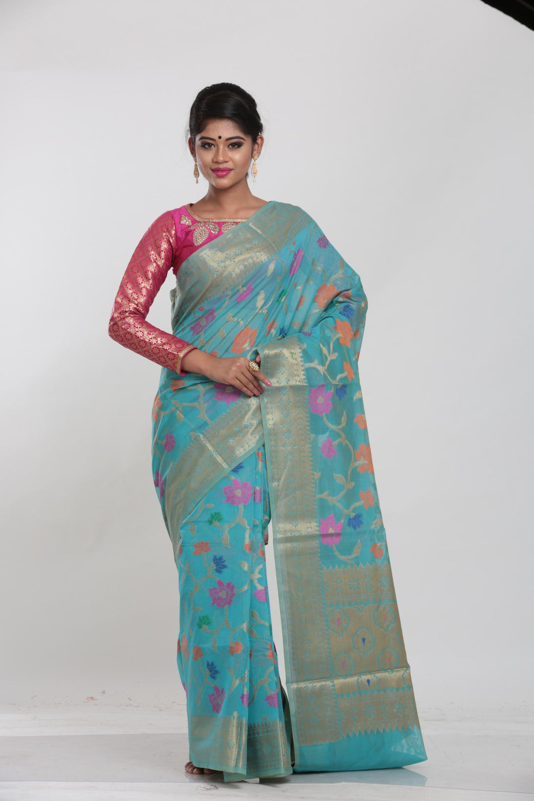 GREEN COLOUR CHANDERI SILK SAREE WITH ALL OVER FLORAL WEAVING