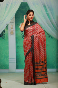 RED COLOUR PRINTED CREPE SILK SAREE WITH CONTRASTING MULTILAYERED BORDER