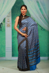 BLUE COLOUR PRINTED CREPE SILK SAREE WITH CONTRASTING MULTILAYERED BORDER