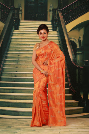 ORANGE COLOUR SILK FANCY SAREE WITH CONTRASTING ALL OVER GOLDEN MOTIF WORK