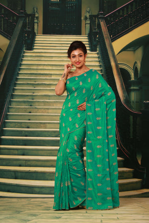 GREEN COLOUR SILK FANCY SAREE WITH CONTRASTING ALL OVER GOLDEN MOTIF WORK