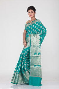 SEA-GREEN COLOUR SELF CHANDERI SILK SAREE WITH ALL OVER GOLDEN HIGHLIGHT