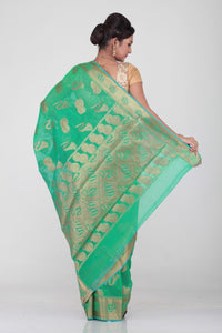GREEN COLOUR SELF CHANDERI SILK SAREE WITH CONTRASTING GOLDEN MOTIF HIGHLIGHTED WEAVING