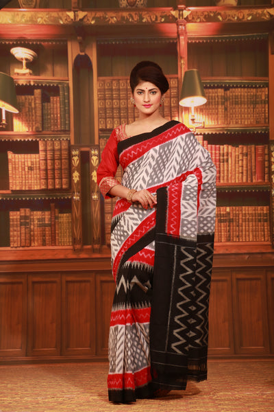 WHITE COLOUR SAMBALPURI COTTON IKKAT SAREE WITH CONTRASTING TIE AND DYE WEAVING