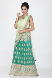 SEA-GREEN COLOUR DUPION SILK LEHENGA WITH CONTRASTING GOLDEN THREAD EMBROIDERY