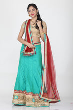 Load image into Gallery viewer, SEA-GREEN COLOUR DUPION SILK LEHENGA WITH CONTRASTING DUPATTA AND BORDER DESIGN
