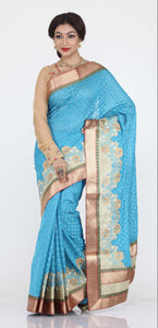 SKY COLOUR WOVEN CHANDERI SILK SAREE WITH CONTRASTING EMBROIDED BORBER