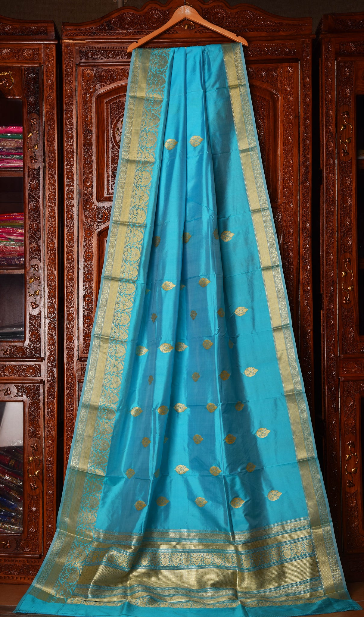 CYAN COLOR BASE KATAN SILK SAREE DECORATED BY GOLDEN ZARI WORK WITH BLOUSE PIECE