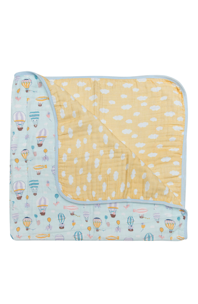 Baby muslin quilt in hot air balloon print with clouds.