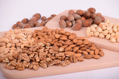 Nuts provide vitamin E, selenium and zinc to the skin. Vitamin E helps skin to retain moisture and the minerals heal small blemishes.