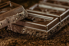 Cacao in dark chocolate contains lads of flavonoids and minerals. This will protect your skin against free radicals caused by oxidative stress.