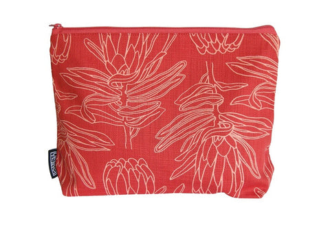 Cotton cosmetic bag with light orange protea motif on a masala background.