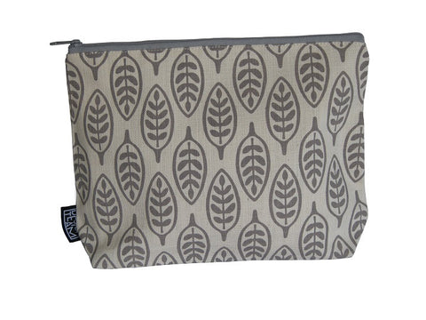 Cotton cosmetic bag with a dark grey paddle leaf motif on a silver grey background.