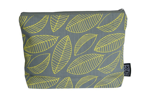 Cotton cosmetic bag with butter yellow foliage motif on a sky grey background.
