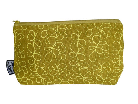 Cotton cosmetic bag with butter yellow foliage motif on a yellow lime background.