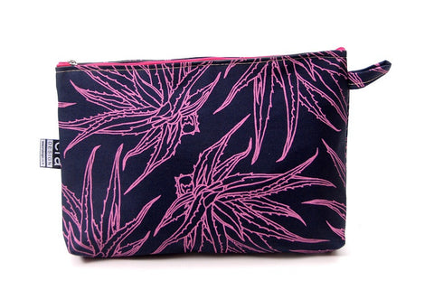 Navy blue bathroom bag with Pink Aloe design and carry tag.