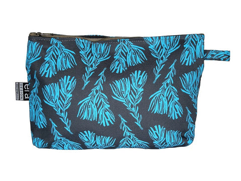 Grey bathroom bag with turquoise fynbos design and carry tag.