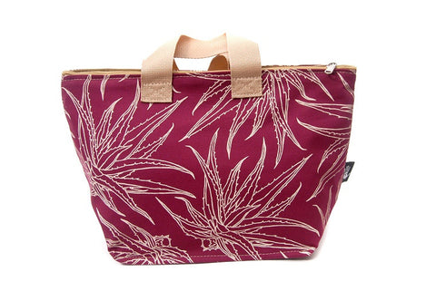 Spacious cotton vanity bag with wide base, carry handles and zipper. Cream Aloe Design on Maroon Background.