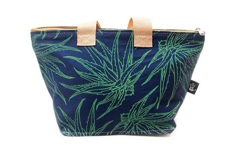 Spacious cotton vanity bag with wide base, carry handles and zipper. Jade Aloe Design on Navy Blue Background.