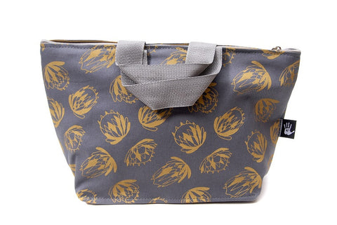 Spacious cotton vanity bag with wide base, carry handles and zipper. Mustard Protea Design on Grey Background.
