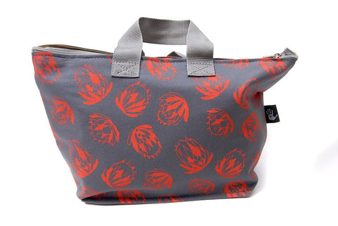 Spacious cotton vanity bag with wide base, carry handles and zipper. Orange Protea Design on Grey Background.