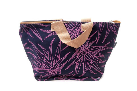 Spacious cotton vanity bag with wide base, carry handles and zipper. Pink Aloe Design on Navy Blue Background.