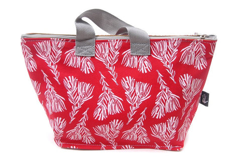 Spacious cotton vanity bag with wide base, carry handles and zipper. White Fynbos Design on Red Background.