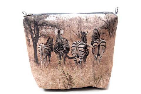 Durable canvas bathroom bag with a digitally printed photo of four zebras in the veld.