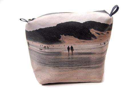 Durable canvas bathroom bag with printed on beach scene.