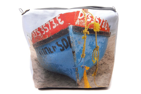 Durable canvas bathroom bag with a digitally printed photo of a fisherman's boat on the beach.