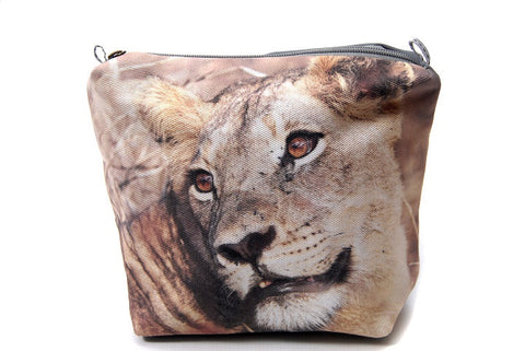 Durable canvas bathroom bag with a digitally printed photo of the face of a lioness.