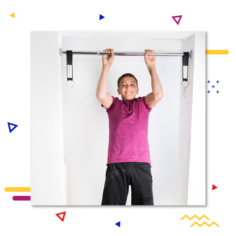 A teenager is doing a pull-up on a doorway chin-up bar.