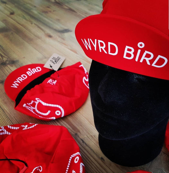Screen print on red 100% cotton cycling cap and an incorporated sweat-band for extra comfort.