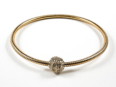 Nice Snake Texture Band With Center Crystal Ball Gold Tone Fashion Bangle