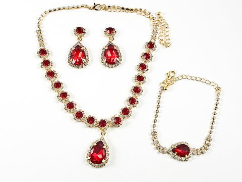 Fancy Elegant Pear Shape Dangle Design Ruby Color Crystal Gold Tone Fashion Earring Bracelet Necklace Set