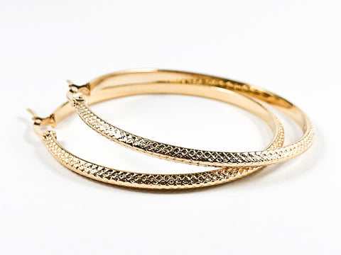 Unique Textured Oval Shape Medium Size Gold Tone Steel Earrings