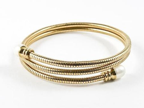 Modern Wraparound With Pearl Ends Gold Tone Steel Bangle