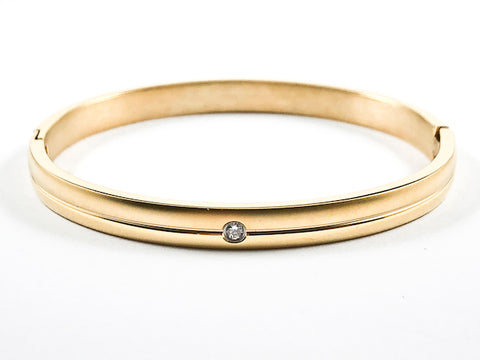 Simple Single Center CZ Gold Tone Steel Bangle