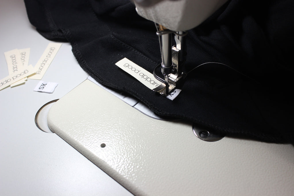 Sewing in Good Apparel Labels to the Simple Knit Jacket in black bamboo jersey