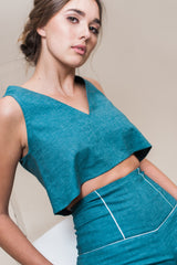 Sleeveless boxy crop top made from recycled poly and hemp chambray.