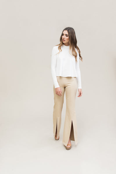 Split Leg Pant. High rise organic denim pant with split leg opening and small front pockets.