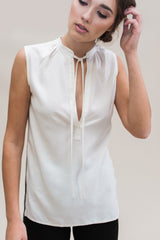 Tie Tunic. Sleeveless bamboo tunic top with neck tie, side slits and deep v neck.