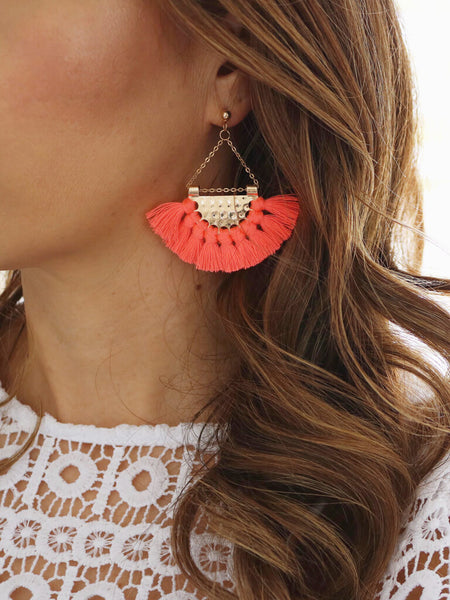 Bright, coral tassel earrings with gold detailing