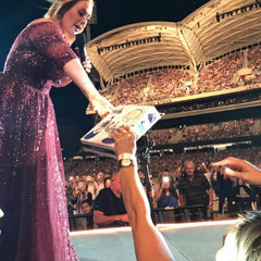 Adele receiving a Play Pouch during her concert