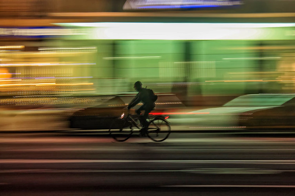 Man on a bicycle at night