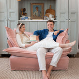 Justine and Jack on a Maker&Son Plaster Velvet Love Seat in the Kitchen at Kemps House