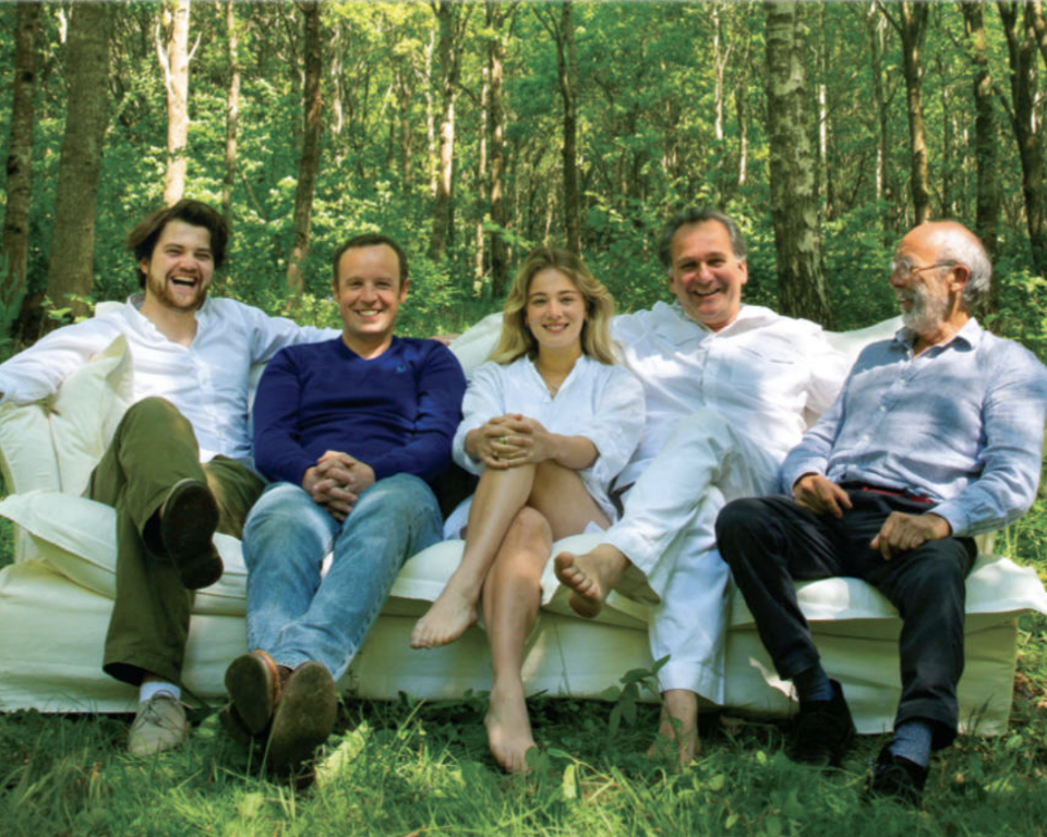 Founders Felix Conran and Alex Willcock sit on a Maker&Son Song Sofa with Marnie and manufacturing partners