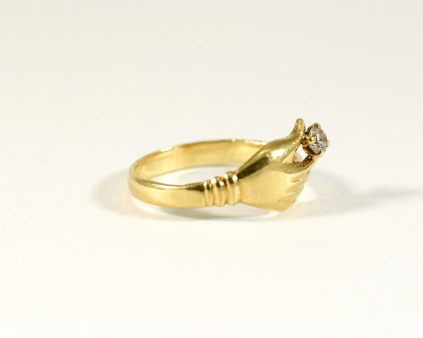 Bague en or jaune main et diamant