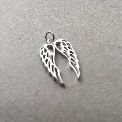Timeless Magic: Double Angel wing pendant